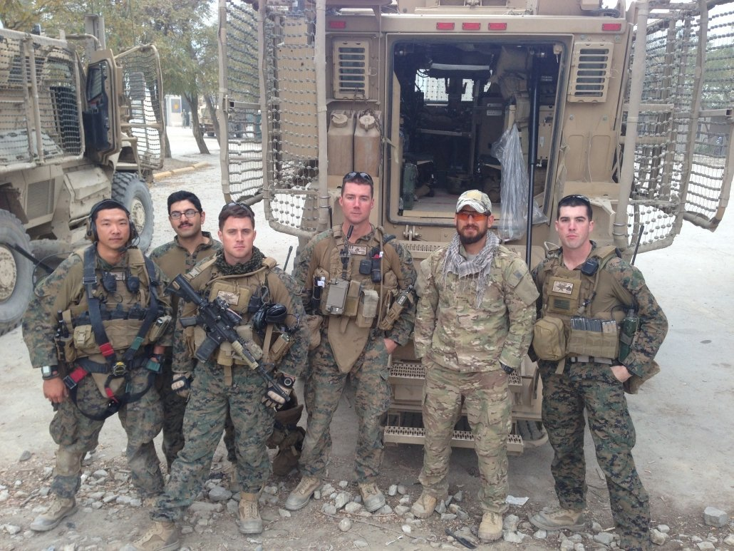 Naylon (third from right) with fellow Marines and a Dari-language interpreter prior to a patrol in Afghanistan.