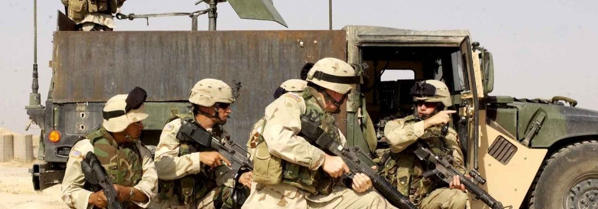 Capt. Dave Kenney, Headquarter Support Battalion platoon leader (right), 1-37 Field Artillery, prepares to send a squad in to clear the objective during a training exercise at Forward Operating Base Endurance. Mosul, Sept. 9, 2004. Photo courtesy of Staff Sergeant Gretel Weiskopf