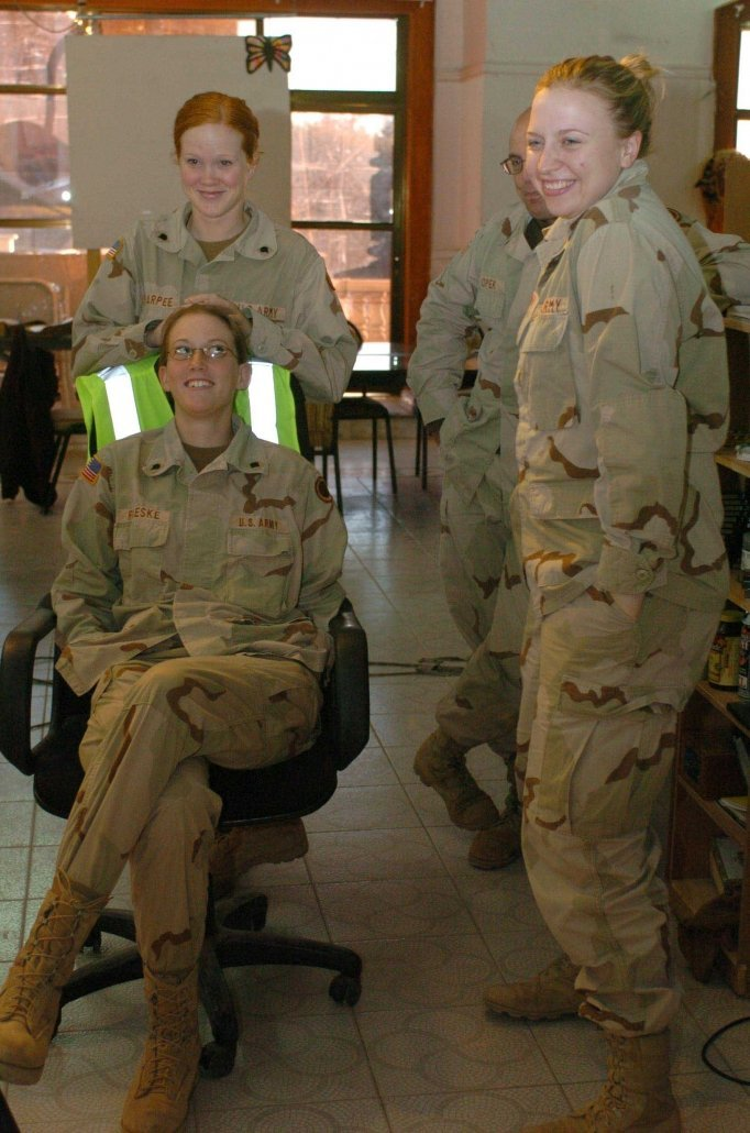 Gretel Sharpee, Sara Roeske (seated), and Mary Flynn (right) review a holiday video message before it was sent to family members in Madison, WI, from Forward Operating Base Freedom in Mosul, Iraq. 2004. Photo Courtesy Gretal Weiskopf