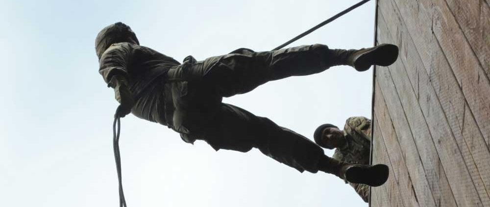 Soldier bounds down a 40 ft tower during a training exercise at Joint Base Lewis-McChord, Wa. U.S. Army photo by Staff Sgt. Jacob Kohrs.