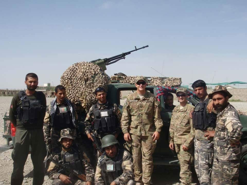 The author and a fellow advisor with their Afghan partners in FOB Rushmore, Paktika Province, Afghanistan, 2012. Photo courtesy of Derek Sentinella