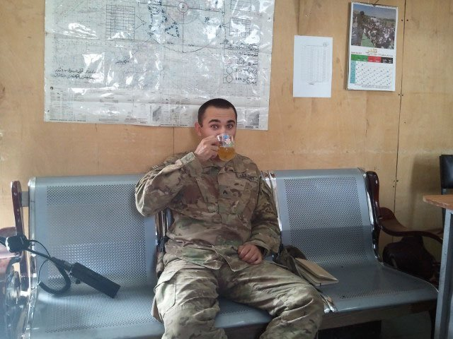 The author drinks chai in the ANA operations center in FOB Rushmore, Paktika Province, Afghanistan, 2012. Photo courtesy of Dan Elinoff