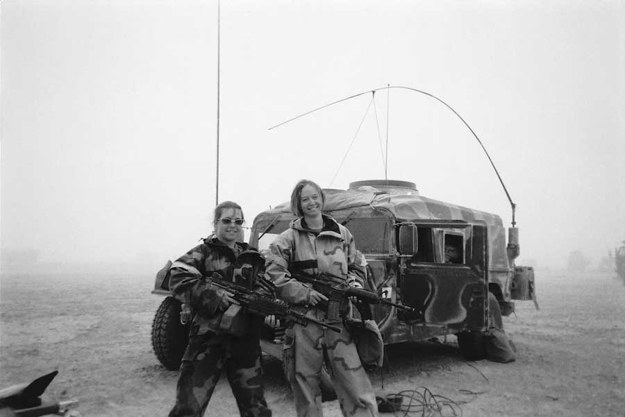 The author and a teammate during the initial invasion of Iraq in March 2003. Courtesy of Kayla Williams