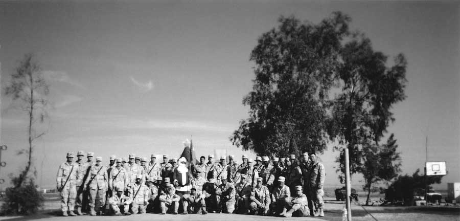 The author's MI company celebrating Christmas 2003 in Tal Afar, Iraq. Courtesy of Kayla Williams