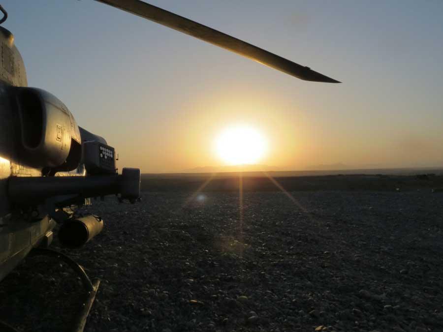 AH-1W Cobra on strip alert at sunset at FOB Shukvani in 2013. Photo courtesy of Anne Boaden