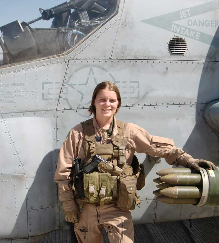 The author beside her AH-1W Cobra standing strip alert at Forward Operating Base Dwyer, Helmand Province, Afghanistan in 2011. Photo courtesy of Anne Boaden