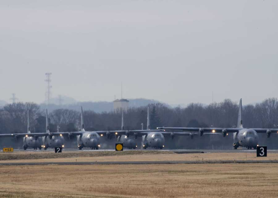 Six C-130J Super Hercules' from Little Rock Air Force Base, Arkansas, perform an Elephant Walk at Yokota AB, Japan. Photo Credit: Airman 1st Class Brieana E. Bolfing