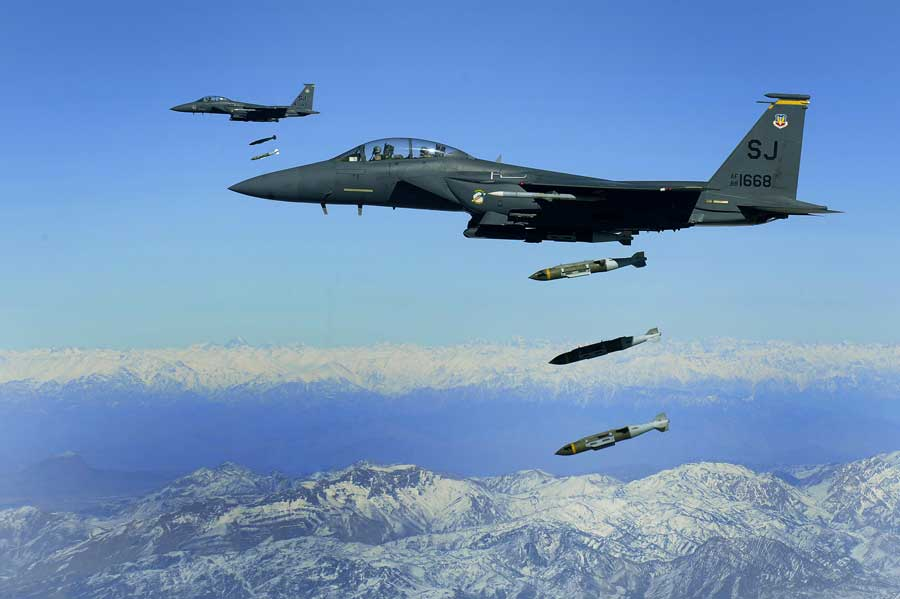 U.S. Air Force F-15E Strike Eagles, from the 335th Expeditionary Fighter Squadron, drop 2,000-pound Joint Direct Attack Munitions on a cave in eastern Afghanistan, Nov. 26. Photo by Staff Sergeant Michael Keller, courtesy of U.S. Air Force.