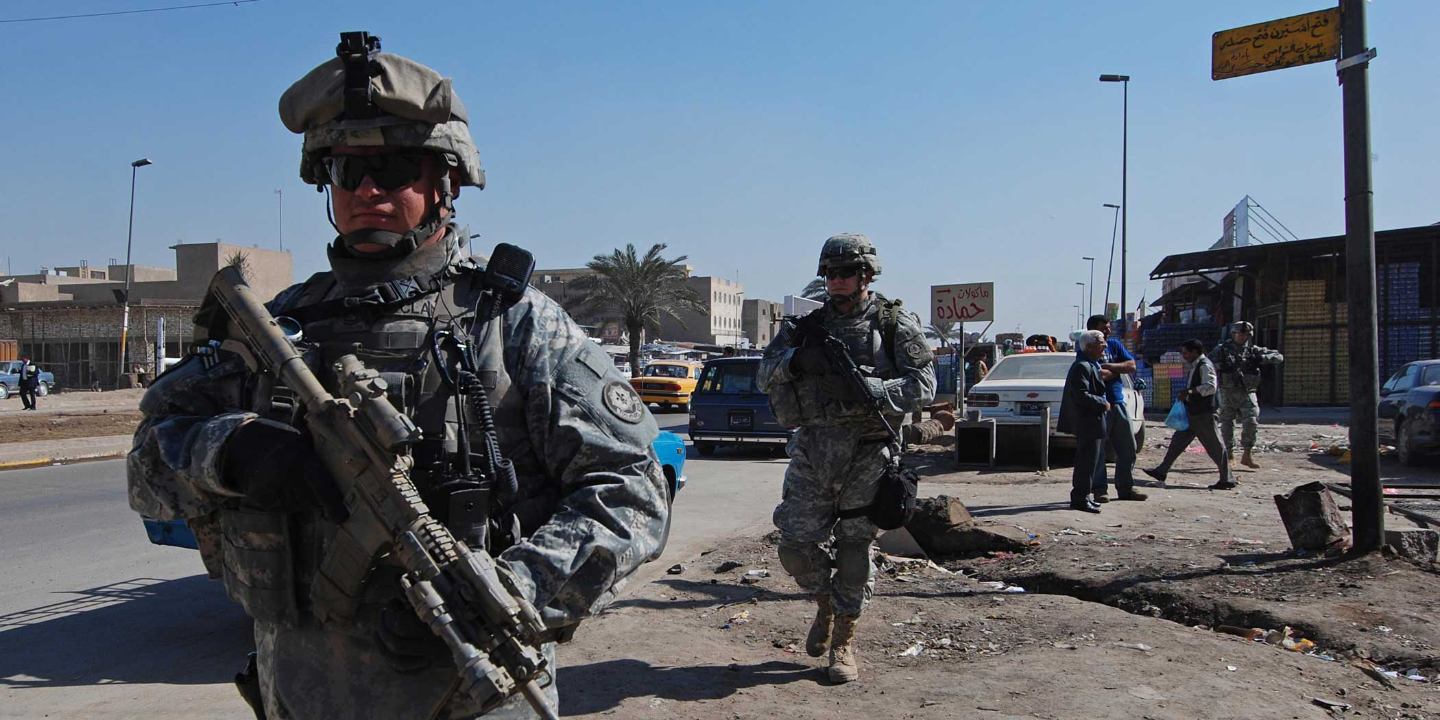 Sgt. 1st Class Timothy Clanin and a platoon sergeant with Headquarters Troop, 1st Squadron, 2nd Stryker Cavalry Regiment, lead their soldiers on a patrol through the Jamila neighborhood of Sadr City in 2008. Photo by Sgt. Michael Pryor, courtesy of the U.S. Army.