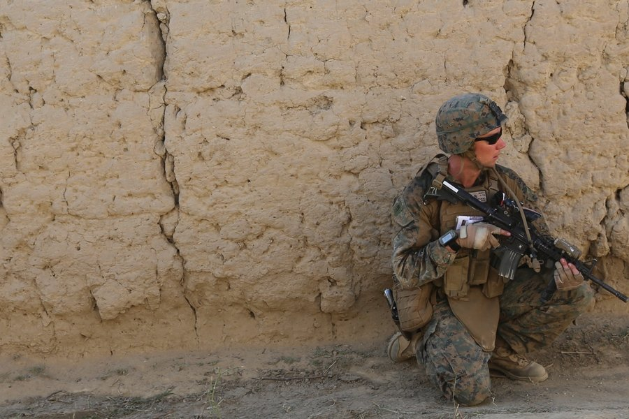 Naylon on an operation in a village outside of Bagram, Afghanistan, 2014. Photo credit: Spc. Jamill Ford for U.S. Army