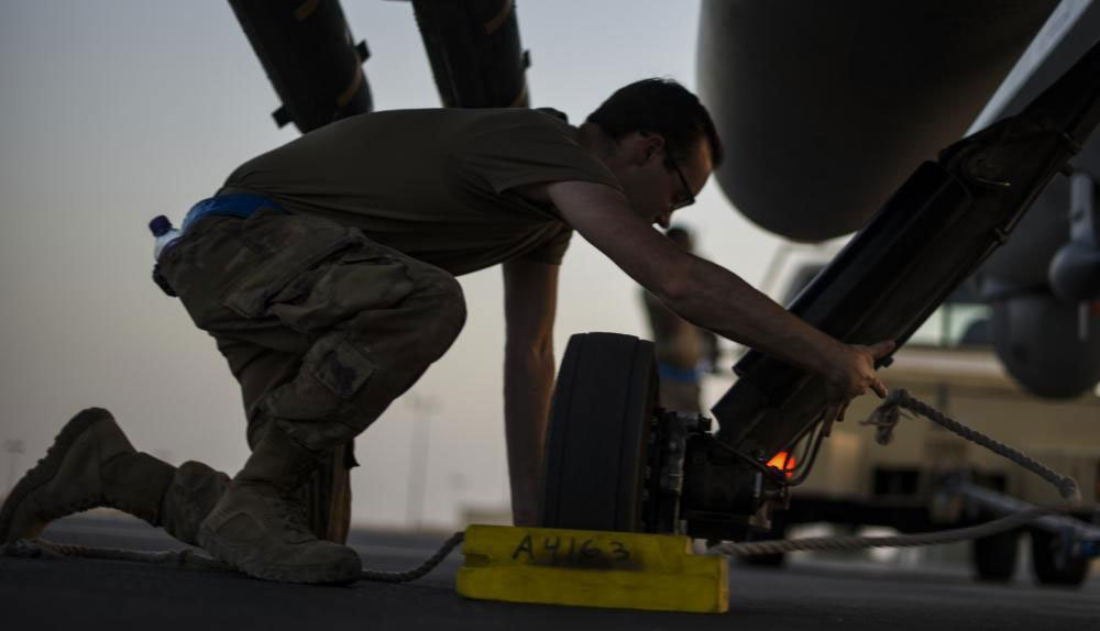 An Airman assigned to the 386th Expeditionary Aircraft Maintenance Squadron sets parking chalks on an MQ-9 Reaper on the flightline of Ali Al Salem Air Base, Kuwait, June 10. Photo by Senior Airman Kevin Tanenbaum, courtesy of U.S. Air Force.