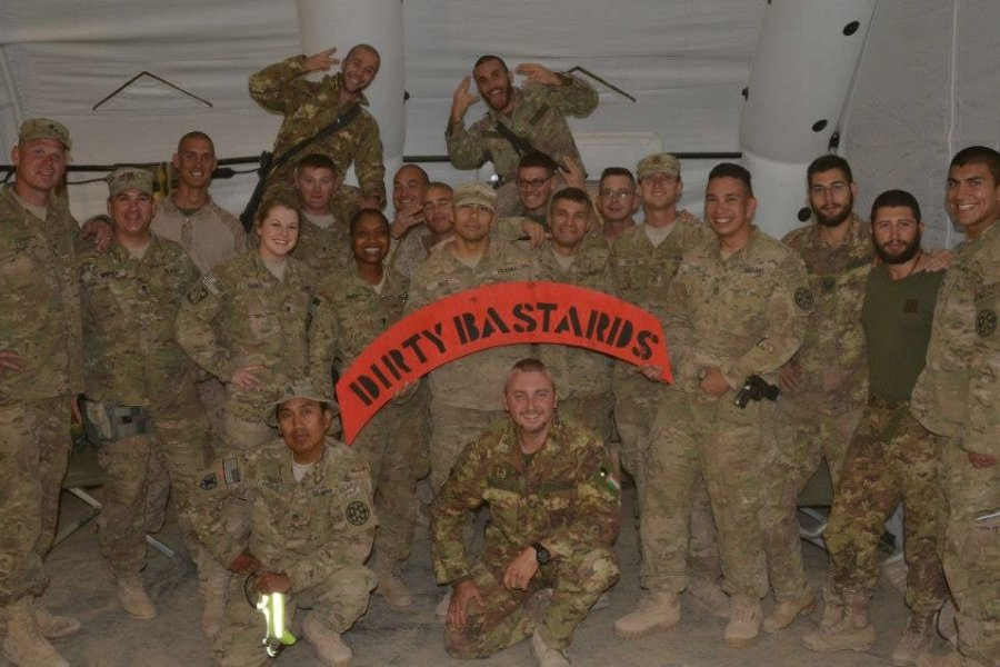 "The ""Dirty Bastards"" quick reaction force, made up of both American and Italian soldiers, poses at Forward Operating Base Lavaredo in Afghanistan in 2012. Photo courtesy of Nate Tilton."