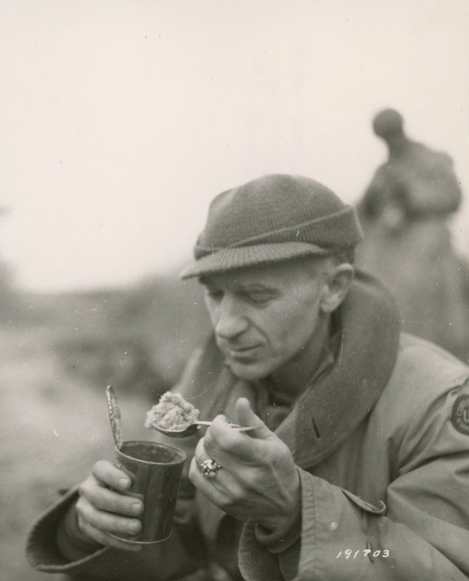 Ernie Pyle eating C rations Anzio Beachhead area, Italy March 18, 1944