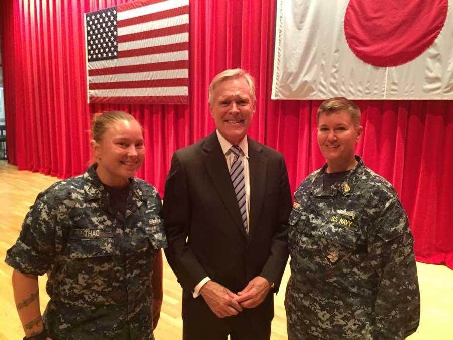 Hull Maintenance Technician Rachael Thao, left, and Sonar Technician Chief Petty Officer Jeni Brett meet Secretary of the Navy Ray Mabus in May 2015 after asking for a review of command sponsorship policies in the Seventh Fleet. Photo by Mass Communications Specialist Amanda Kitchener, courtesy of U.S. Navy.