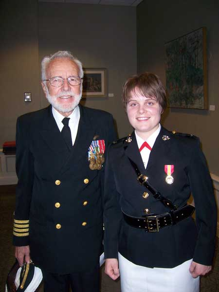 The author with her grandpa, Retired Navy Capt. Robin McGlohn, during her commissioning in May 2006. He later presented his naval aviator wings to her when she graduated flight school and winged in June 2009. Photo courtesy of the author.