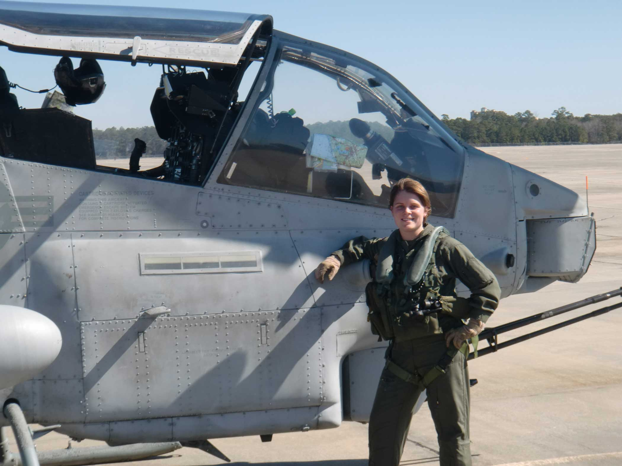 The author standing beside the first AH-1W SuperCobra she flew as aircraft commander in February 2011 with Marine Light Attack Helicopter Squadron 467.