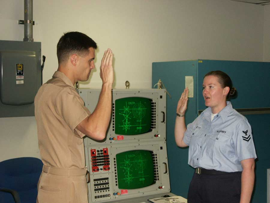 Ensign M. Johnson, left, administers Jeni Brett's reenlistment oath in 2002 in Point Loma, California. Photo courtesy of the author.