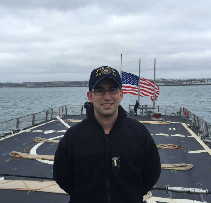 Ensign Thibaut Delloue stands on the deck of the USS Carney while deployed off the coast of northern France in 2015. Photo courtesy of the author.