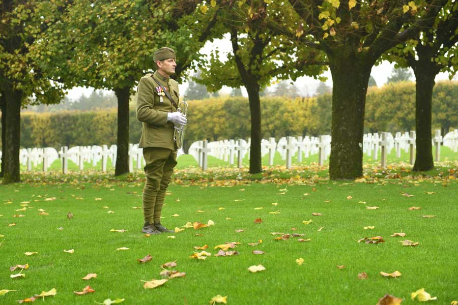 Pascal Boullieaux, a French World War I reenactor and baker, waits to sound his bugle during the Veterans Day ceremony at Meuse-Argonne American Cemetery and Memorial near the Argonne Forest in France, Nov. 11, 2017 – known as Remembrance Day in France to commemorate the end of World War I. Photo by Senior Airman Nick Emerick, courtesy of the U.S. Air Force.