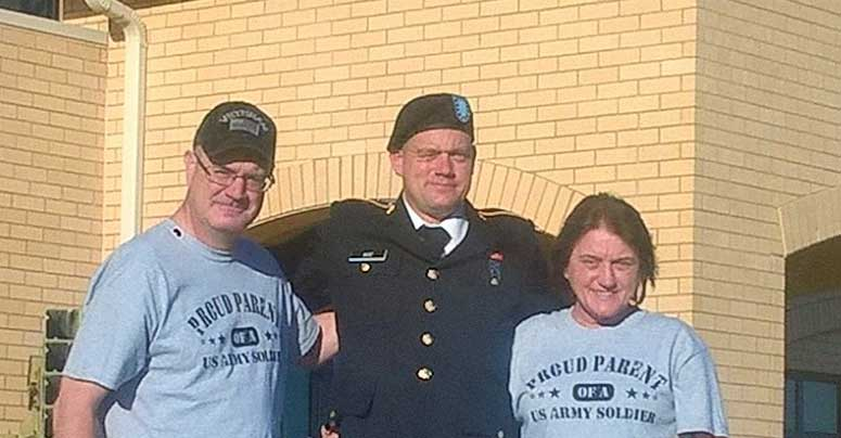 Dave Boe, Lars Boe, and Conny Hemmer pose at the barracks while attending Lars Boe's graduation from Army basic training at Fort Sill, Oklahoma. Photo courtesy of the author.