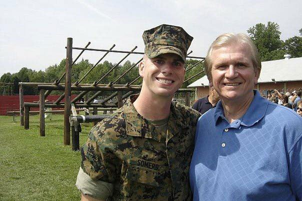 Jack Somers poses with his dad at his Marine Corps Officer Candidates School graduation in 2006. Somers was one of at least six Marines and Navy corpsmen who deployed from Camp Pendleton, California, to Afghanistan in 2010 who later developed seizures or seizure-like episodes. Photo courtesy of Jack Somers.