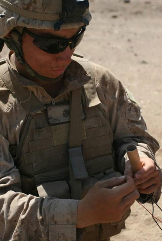 Brandon Alt wires explosives during his deployment to Afghanistan in 2010. Photo courtesy of Brandon Alt.