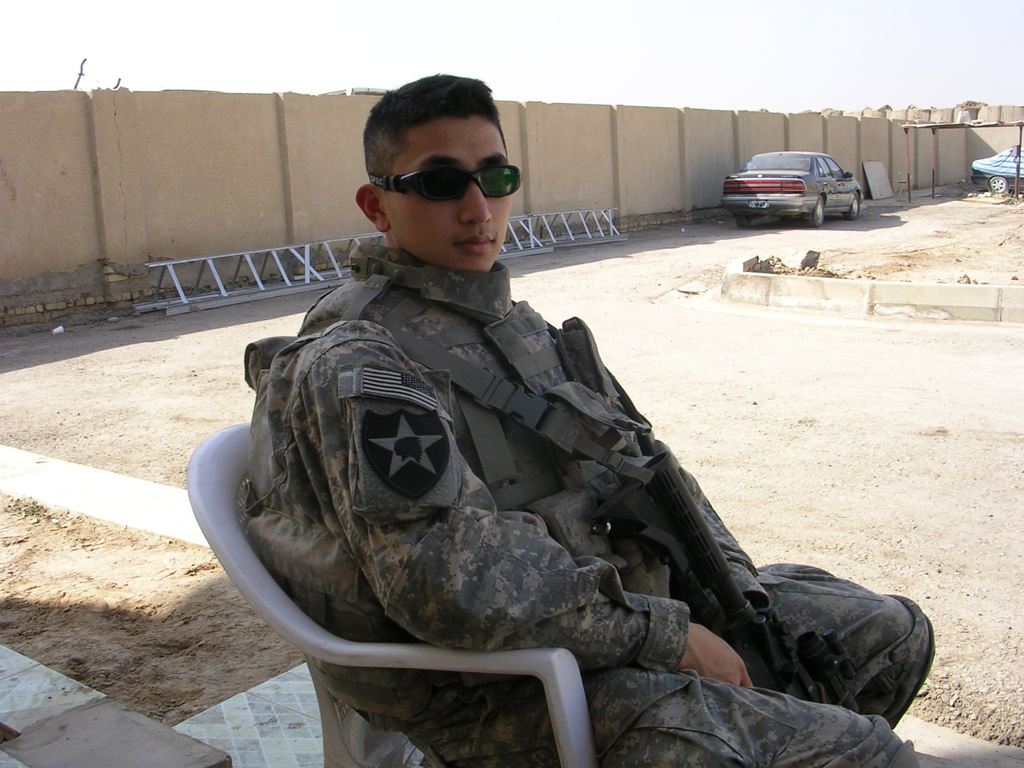 Hunter Lu rests at an Iraqi army base after a patrol in 2007 in Baqubah, Iraq. Photo courtesy of the author.