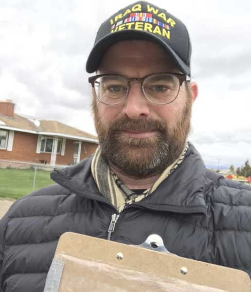 Joshua Manning goes door to door to get out the vote in Helena, MT, in 2018. Photo courtesy of the author.