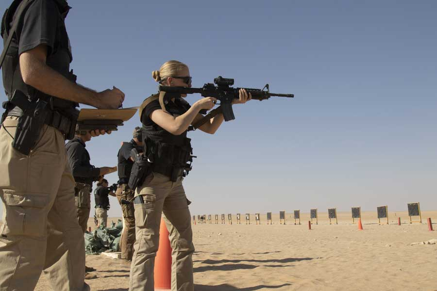 Missouri National Guard Spc. Lauren Cabrera prepares to shoot an M4 carbine during a specialized law enforcement weapons qualification course on the Udairi Range Complex, Kuwait, October 19. Cabrera, a Kansas City, Missouri native, is studying criminal justice. Photo by Sgt. Khylee Woodford, courtesy of the U.S. Army Reserve.