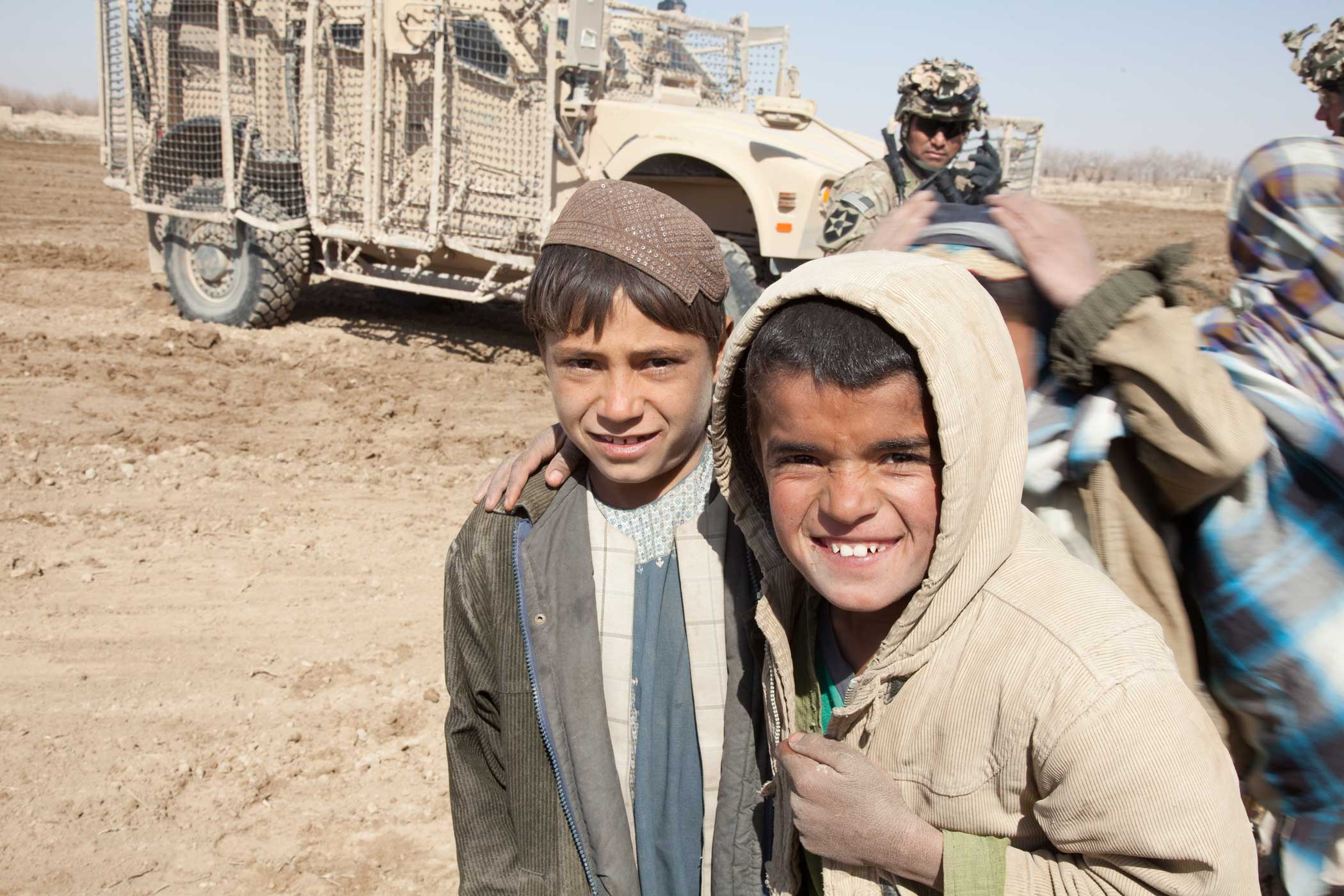 Children from a nearby village pose for a photograph in Zharay district, Kandahar province, Afghanistan, in 2012. Photo by Spc. Jason Nolte, courtesy of U.S. Army.