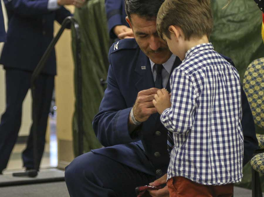 Col. Matthew Komatsu, director of plans and strategy on the Alaska National Guard Joint Staff, helps his son, Finnegan, pin his new rank on his beret during a Sept. 4, 2019, promotion ceremony at Joint Base Elmendorf-Richardson in Alaska. Photo by Pfc. Grace Nechanicky, courtesy of the U.S. Army National Guard. (U.S. Army National Guard photo by Pfc. Grace Nechanicky/Released)