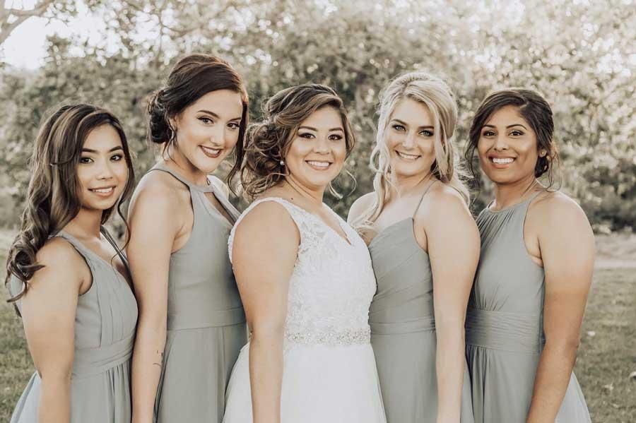 Ohu (left) attends the wedding of Jennifer Charlson (center), a Marine she served alongside in Okinawa. Courtesy of Jennifer Charlson.