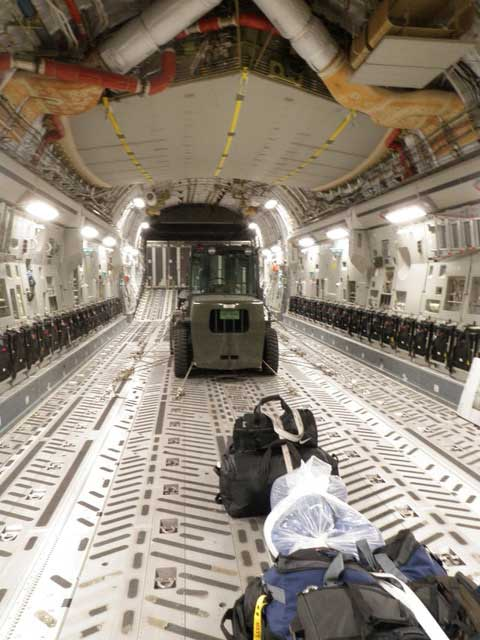 A lone forklift in the back of a C-17. Photo courtesy of the author.