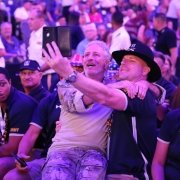 U.S. Army veteran Tom Bomke takes a selfie with Jon Stewart at the DoD Warrior Games opening ceremony, June 22, 2019, at Amalie Arena in Tampa during the Department of Defense Warrior Games. Photo by Spec. Seara Marcsis, courtesy of the U.S. Army.