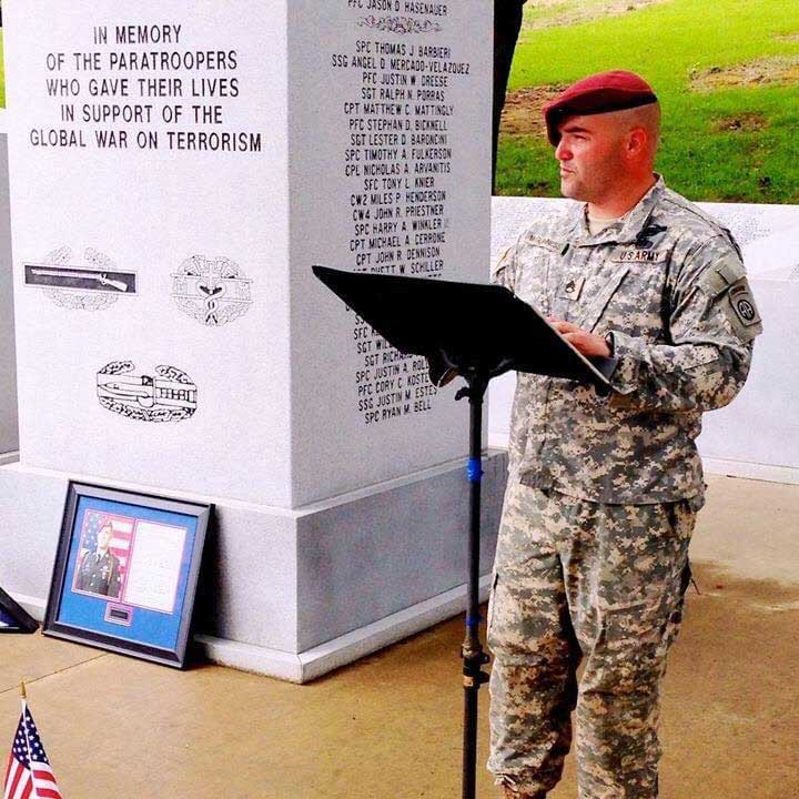 Mike McGuinness gives a speech at a service for Cpl. Nick Olivas, who died in Afghanistan.