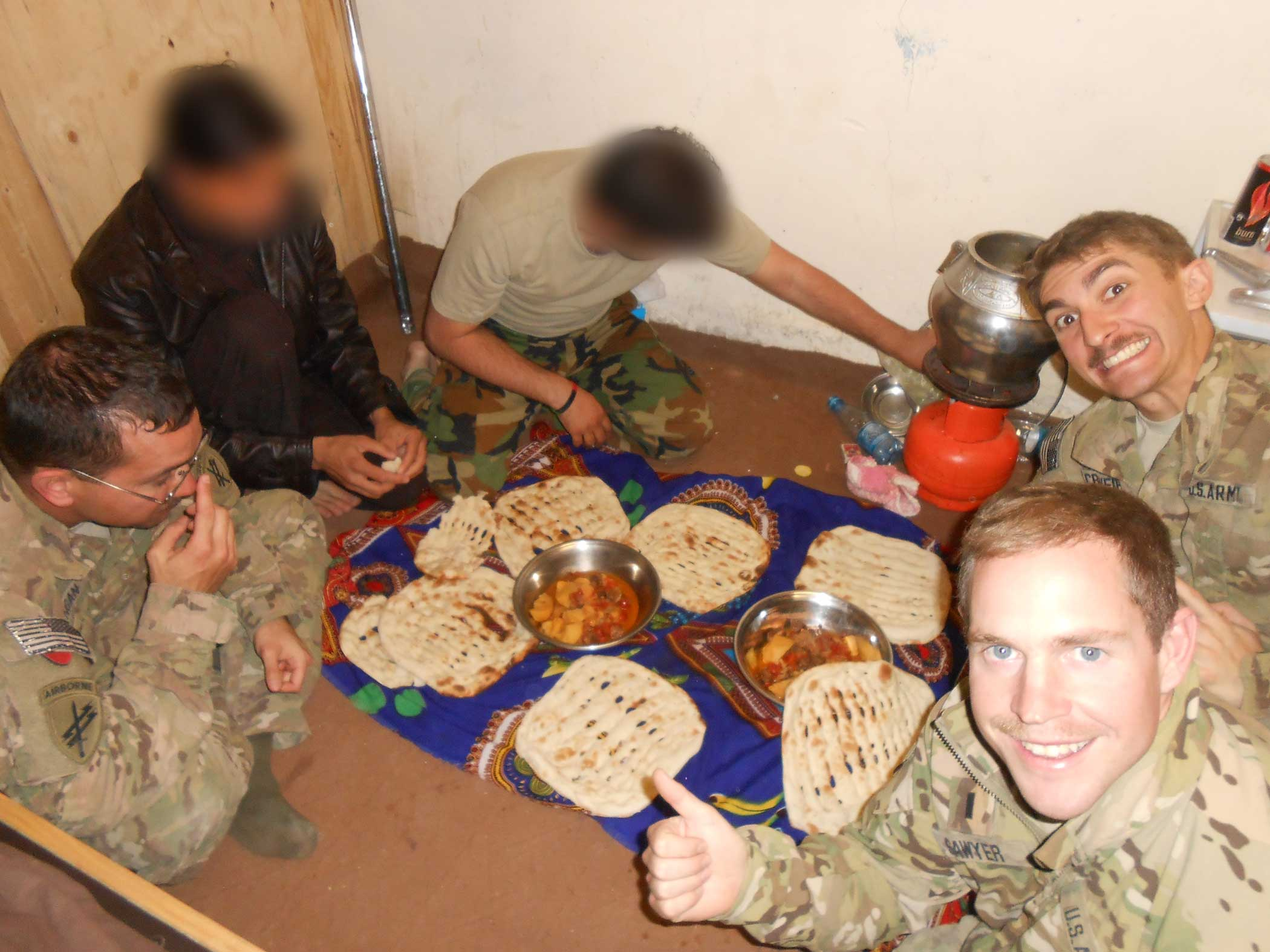 The author shares a meal with his civil affairs team and some Afghan friends. Courtesy of the author.