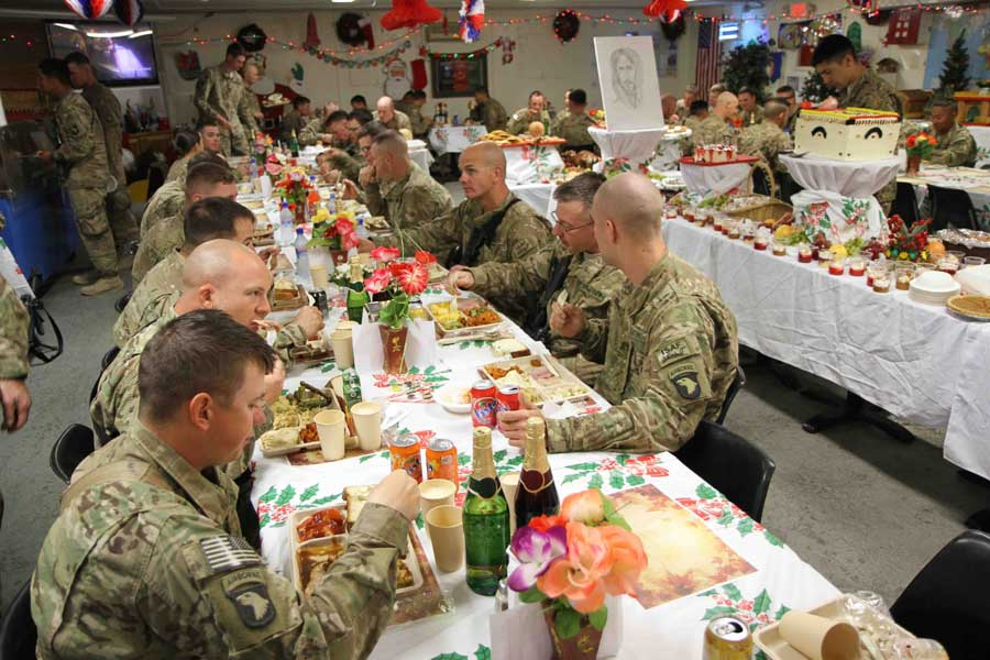 Soldiers enjoy their Christmas-day lunch at the Camp Clark, Afghanistan, dining facility in 2012. Photo by Sgt. 1st Class Abram Pinnington, courtesy U.S. Army.