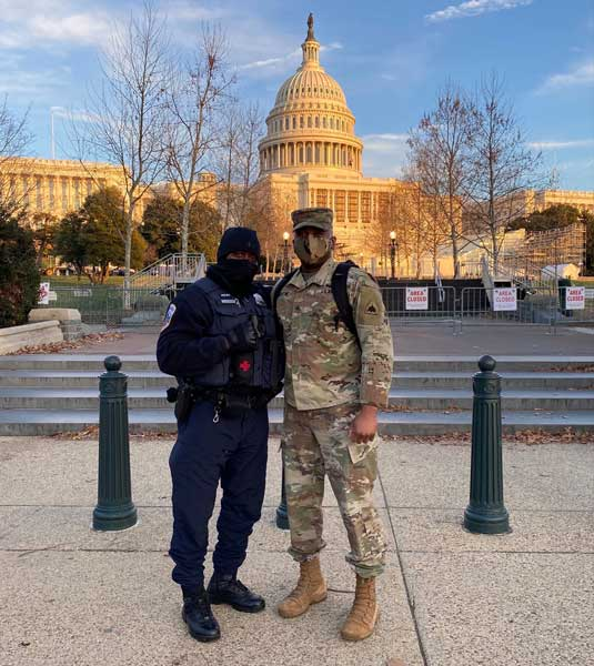 Officer Kevin Valentine, Washington, D.C. Metropolitan Police Department, and his son, Sgt. Kevin Valentine, public affairs specialist, District of Columbia Army National Guard, pose for a photo in front of the U.S. Capitol building, Jan. 7. Photo by Senior Airman Coda Doyle, courtesy of U.S. Air Force.