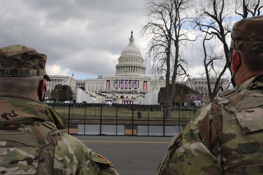 U.S. Soldiers with the National Guard watch the 59th Presidential Inauguration near the U.S. Capitol in Washington, D.C., Jan. 20. Photo by Staff Sgt. Devlin Drew, courtesy of U.S. Army National Guard.