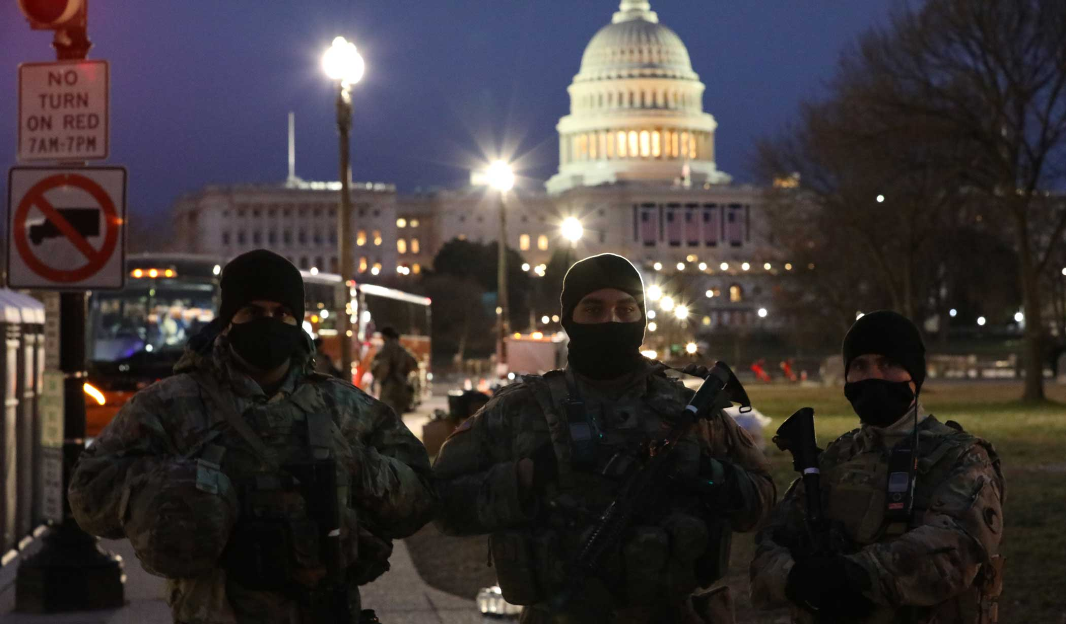 From Left: U.S. Army Pfc. Ashkan Shirazifar, Spc. Jason Ford, and Sgt. 1st Class James Melady, all with the Virginia Army National Guard, stand at a security post near the U.S. Capitol Complex Jan. 16. Photo by Staff Sgt. Devlin Drew, courtesy of U.S. Army National Guard.