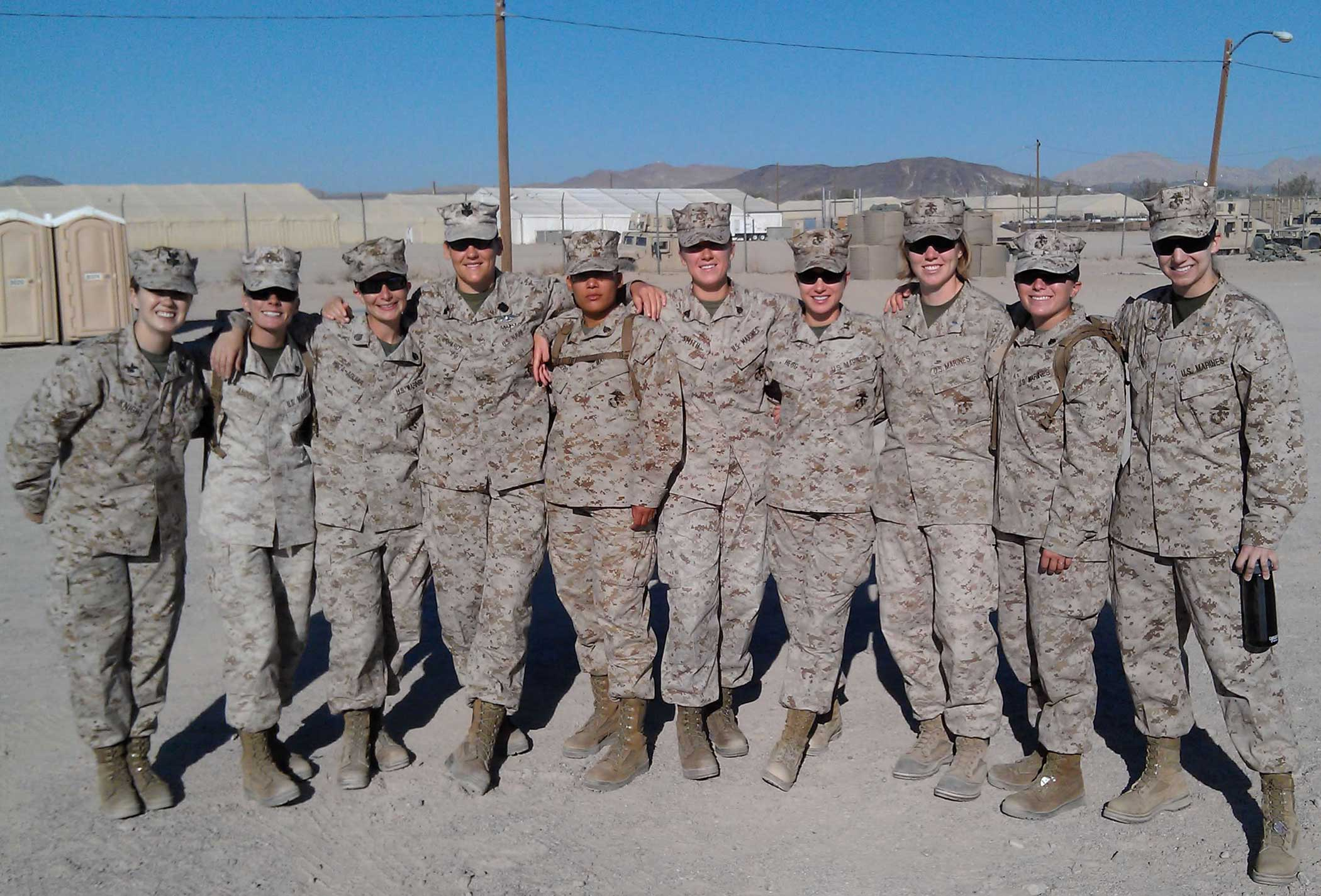 The author, far right, poses with other Marines while training in Barstow, California. To the author, it's just a group of Marines, but she wonders what others see. Photo courtesy of the author.