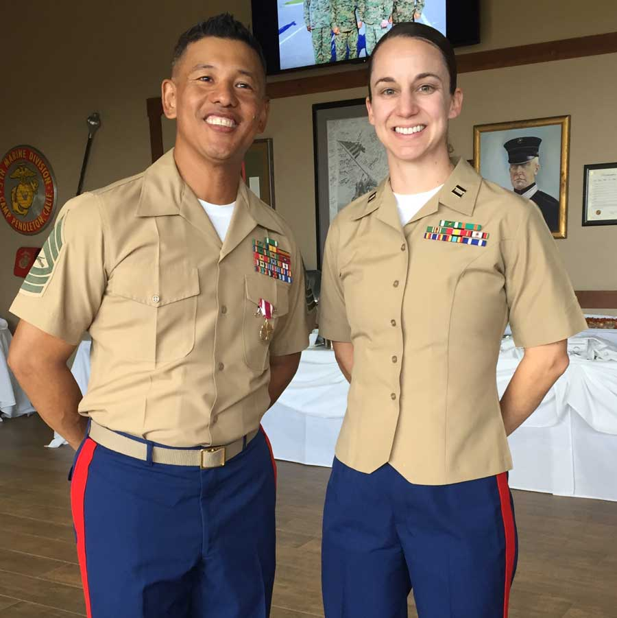 A photo of Janell Hanf, right, with a colleague at his retirement ceremony shows the differences between men's and women's Marine Corps uniforms.