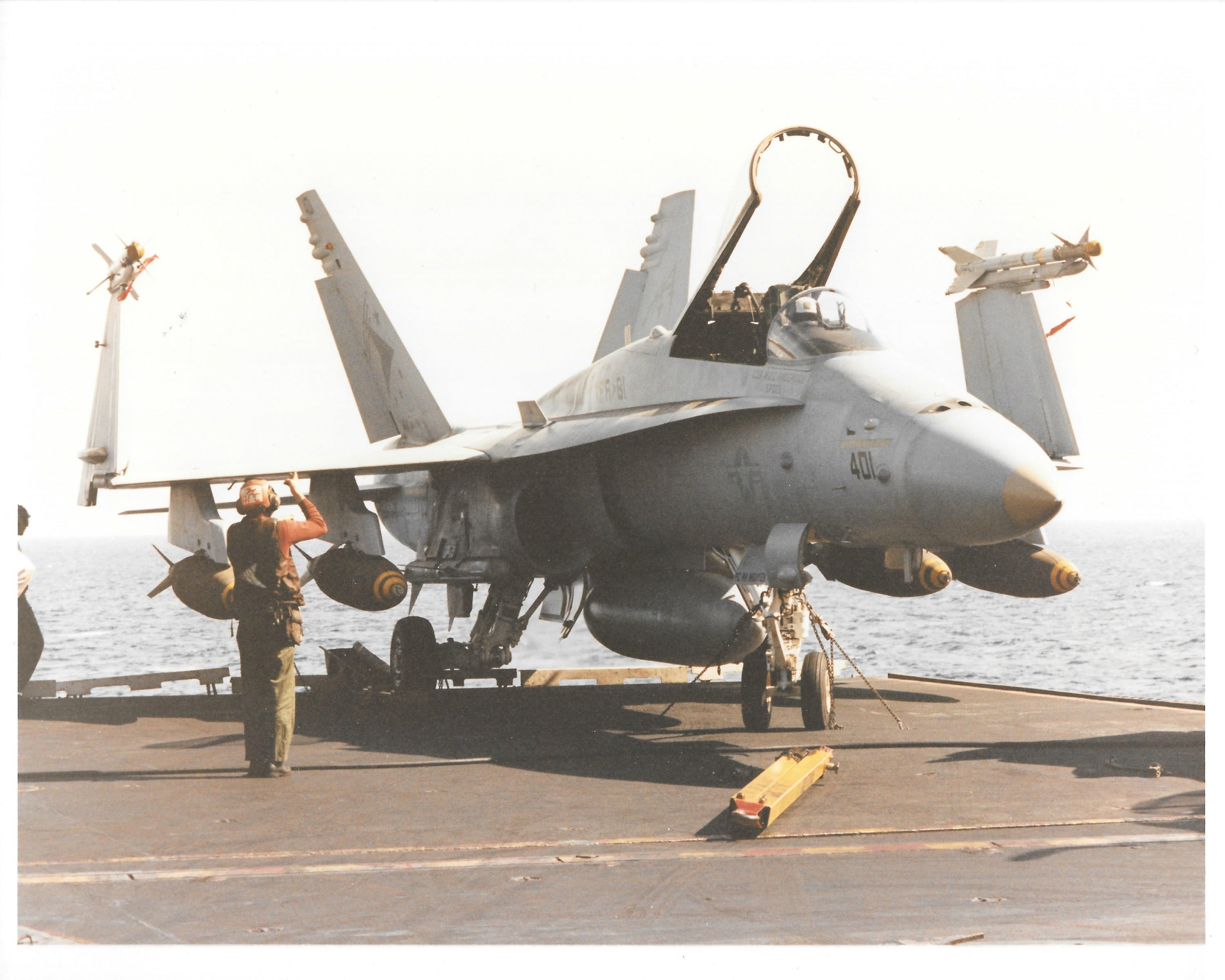 Fox's F/A-18 aboard the USS Saratoga before launching. The MiG profile above the side number on the nose shows it has had one confirmed kill—on Jan. 17, 1991. Photo courtesy of Fox.