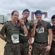 Janell Hanf and Marines from her unit celebrate at the end of the Camp Pendleton Mud Run. Photo courtesy of the author.