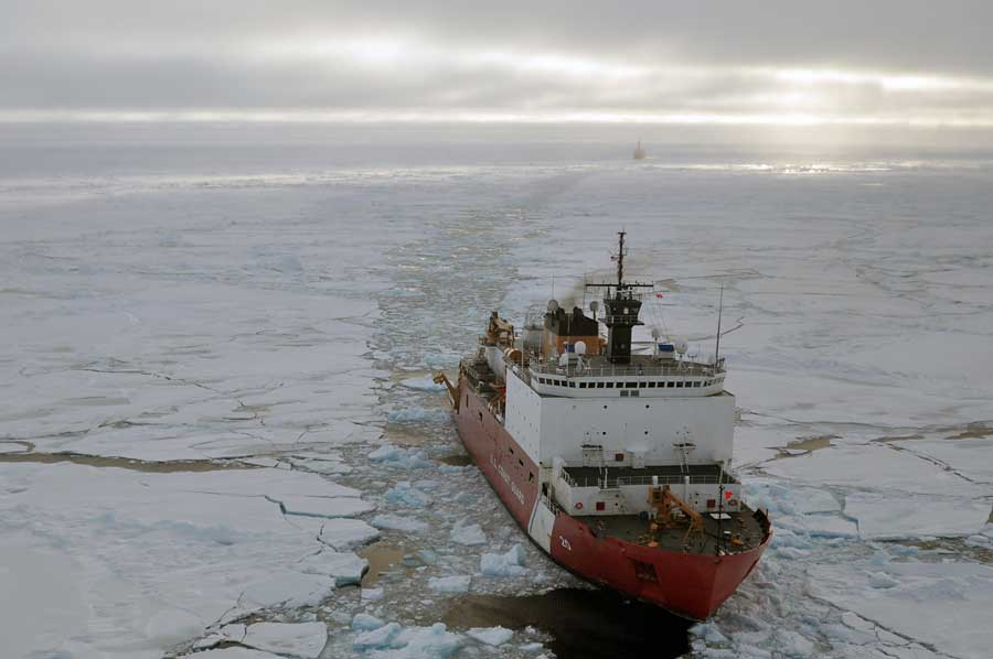 Coast Guard Cutter Healy breaks ice ahead of the Canadian Coast Guard Ship Louis S. St-Laurent in 2009. Photo by Petty Officer Patrick Kelley, courtesy of U.S. Coast Guard.