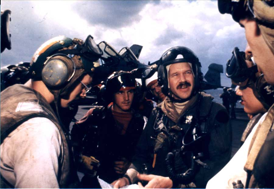 Mark Fox tells his squadron maintenance team and flight deck personnel about the day's mission. Photo courtesy of Fox.