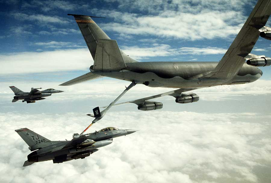 A 401st Tactical Fighter Wing F-16C Fighting Falcon aircraft refuels from a KC-135 Stratotanker aircraft as another F-16 stands by during Operation Desert Storm. Photo courtesy of U.S. Air Force.