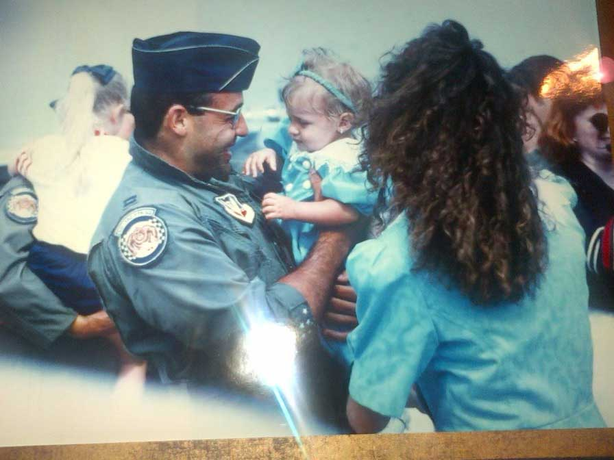 Rodriguez greets his wife, Trish, and his daughter, Amanda, upon his return home from Operation Desert Storm. Photo courtesy of Rodriguez.