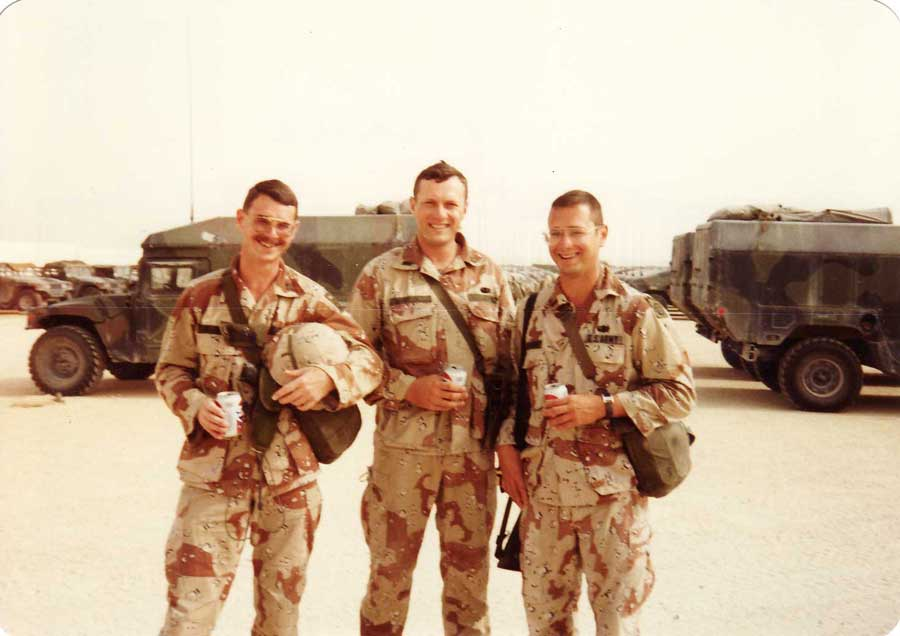 Chief Warrant Officer Jeff Brasfield (battalion physician assistant), 1st Lt. Harry L. Whitlock (medical platoon leader), and 1st Lt. Mark Stevens (mortar platoon leader), taken on Christmas Day 1990 at Champion Main compound in Saudi Arabia. Photo courtesy of Harry L. Whitlock.