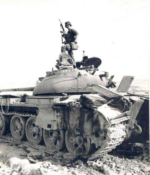 Dave Boe poses on top of a destroyed Iraqi tank after Desert Storm. Photo courtesy of the author.